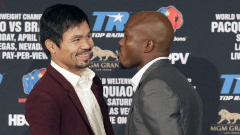Manny Pacquiao and Timothy Bradley Jr. pose during a news conference in Beverly Hills, Calif., on Tuesday, Jan. 19, 2016. Pacquiao and Bradley are scheduled to fight on April 9, 2016, in Las Vegas for Bradley's WBO welterweight title. (AP Photo/Nick Ut)